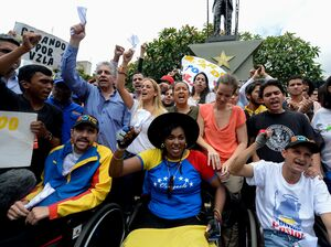 Lilian Tintori, second row center, in white blouse, the wife of jailed opposition leader Leopoldo Lopez, takes part in a demonstration in Caracas on Aug. 31. Venezuelan President Nicolas Maduro vowed Tuesday to jail opposition leaders if they incite violence during upcoming protests seeking a referendum on removing him from power.