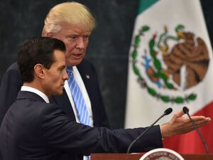 Republican presidential nominee Donald Trump and Mexican President Enrique Pena Nieto at a joint conference in Mexico City Wednesday.