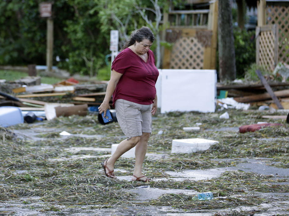 A resident checks on damage from Hurricane Hermine in Cedar Key, Fla. Hermine was downgraded to a tropical storm after it made landfall. Authorities say the storm could regain hurricane status by the time it hits the Mid-Atlantic states by Monday. (John Raoux/AP)