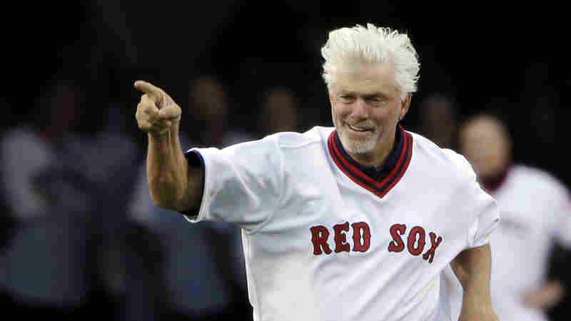 """Boston Red Sox former pitcher Bill """"Spaceman"""" Lee runs onto the field to join teammates during pre-game ceremonies at Fenway Park on May 5, 2015."""
