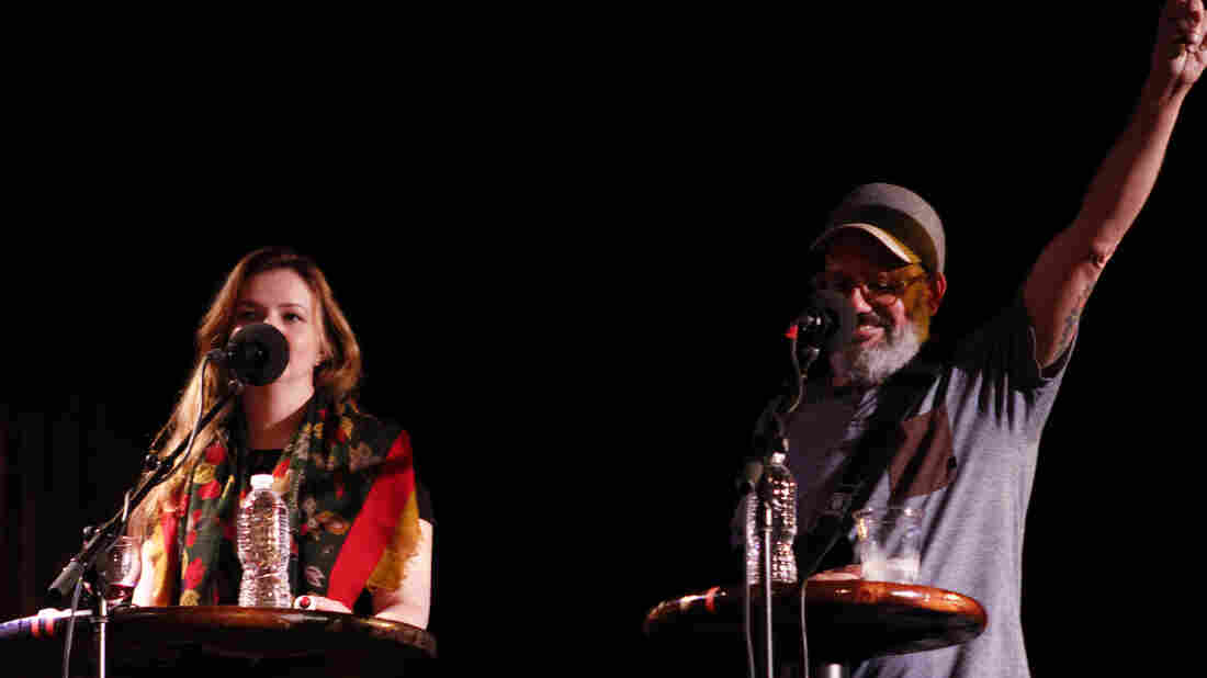 David Cross and wife Amber Tamblyn appear on the Ask Me Another stage at the Bell House in Brooklyn, New York.