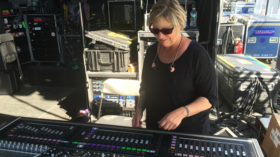 Karrie Keyes stands at her soundboard at a show at Boston's Fenway Park in August 2016. From here, she communicates with the members of Pearl Jam to get the monitor mix just right. (Caroline Losneck)