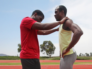 Guide Wesley Williams (left) lines up blind long jumper and sprinter Lex Gillette on the track before making a long jump during practice at the U.S. Olympic Training Center in San Diego. Gillette started losing his sight when he was 8 years old.