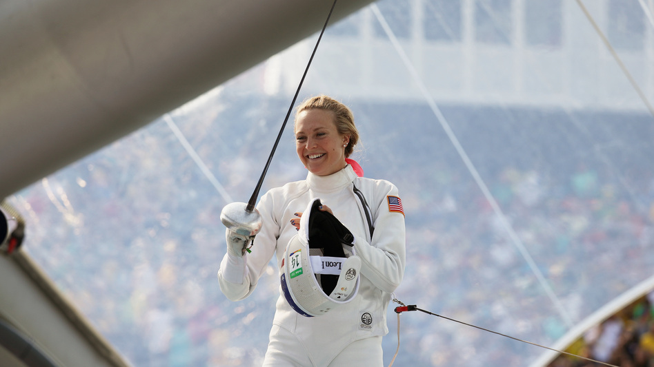 "American Margaux Isaksen smiles during the women's fencing in the Modern Pentathlon on Aug. 19 at the Rio Olympics. She finished fourth in London in 2012 and 20th in Rio. ""It makes you feel sort of worthless,"" Isaksen says of her performance. She calls this current period a ""post-Olympic depression."" (Getty Images)"