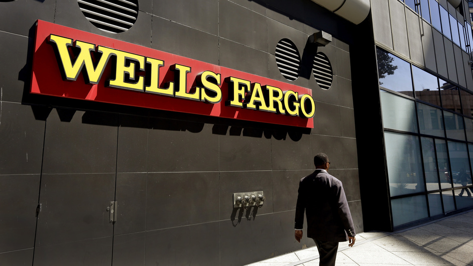 Regulators announced Thursday that Wells Fargo is being fined $185 million to settle allegations that it secretly opened unauthorized accounts for customers in order to meet sales goals. (Ben Margot/AP)