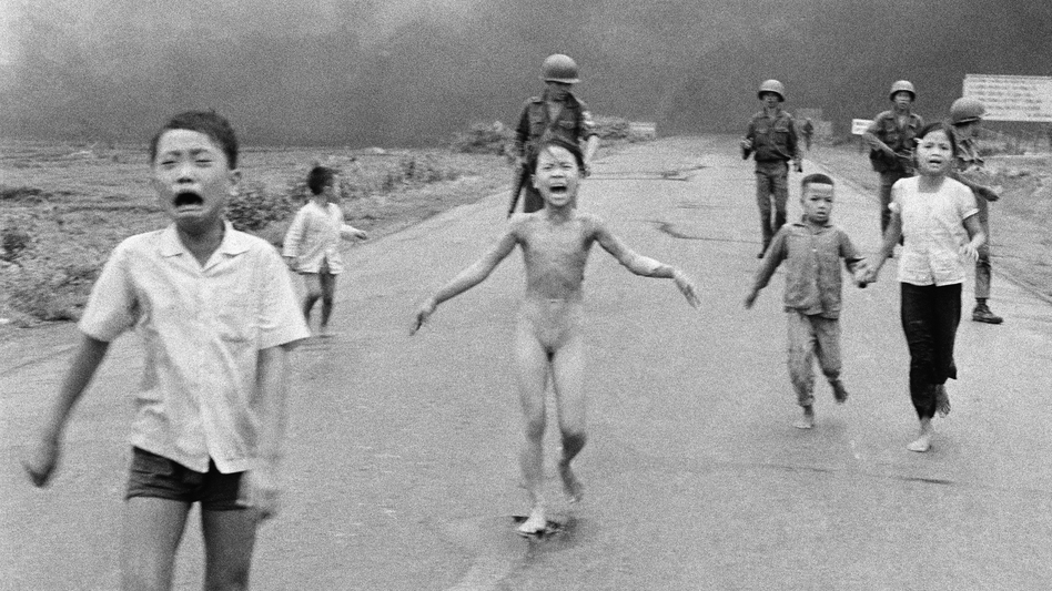 South Vietnamese forces follow terrified children, including 9-year-old Kim Phuc (center), as they run down Route 1 near Trang Bang after an aerial napalm attack on suspected Viet Cong hiding places, June 8, 1972.