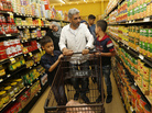 Nadim Fawzi Jouriyeh, a Syrian refugee who arrived in the United States in August with his family, pushes a shopping cart in El Cajon, Calif.