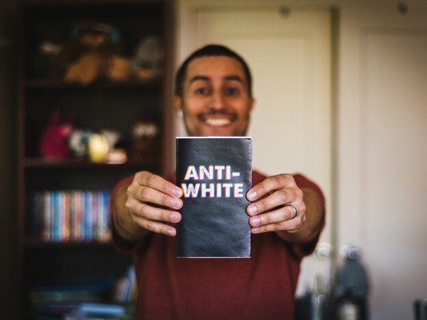 Jose Vazquez holds a book he found during the D.C. Public Library's banned book scavenger hunt.