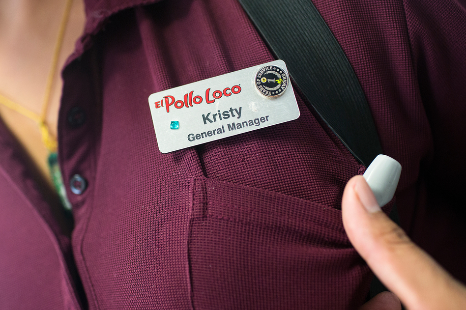 General Manager Kristy Ramirez decorated the name tag she recently received when she was promoted at one of Mendelsohn's El Pollo Loco franchises.