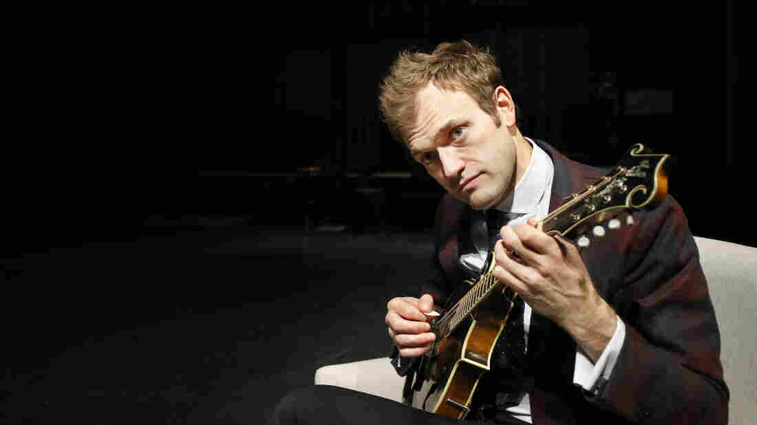 Chris Thile plays his mandolin onstage at the Fitzgerald Theater in St. Paul, Minn.
