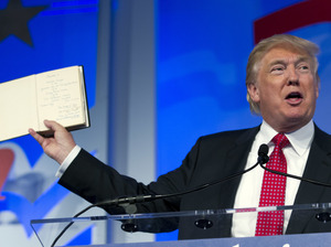 Republican presidential candidate Donald Trump holds up a Bible that was given to him by his mother as he speaks during the Values Voter Summit in Washington, D.C., on Sept. 25, 2015.