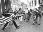 """""""The Soiling of Old Glory"""" was taken on April 5, 1976, during the Boston busing desegregation protests."""