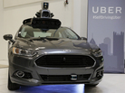 A self-driving Ford Fusion Hybrid Uber is displayed last week at the companies' Advanced Technologies Center in Pittsburgh. On Tuesday, the Department of Transportation will announce a set of policy proposals designed to ensure the safety of autonomous and automated vehicles.