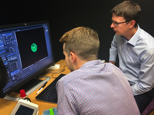 Fredrik Lanner of the Karolinska Institute in Stockholm and his student, Alvaro Plaza Reyes, examine a magnified image of an human embryo they used to attempt to create genetically modified healthy human embryos.
