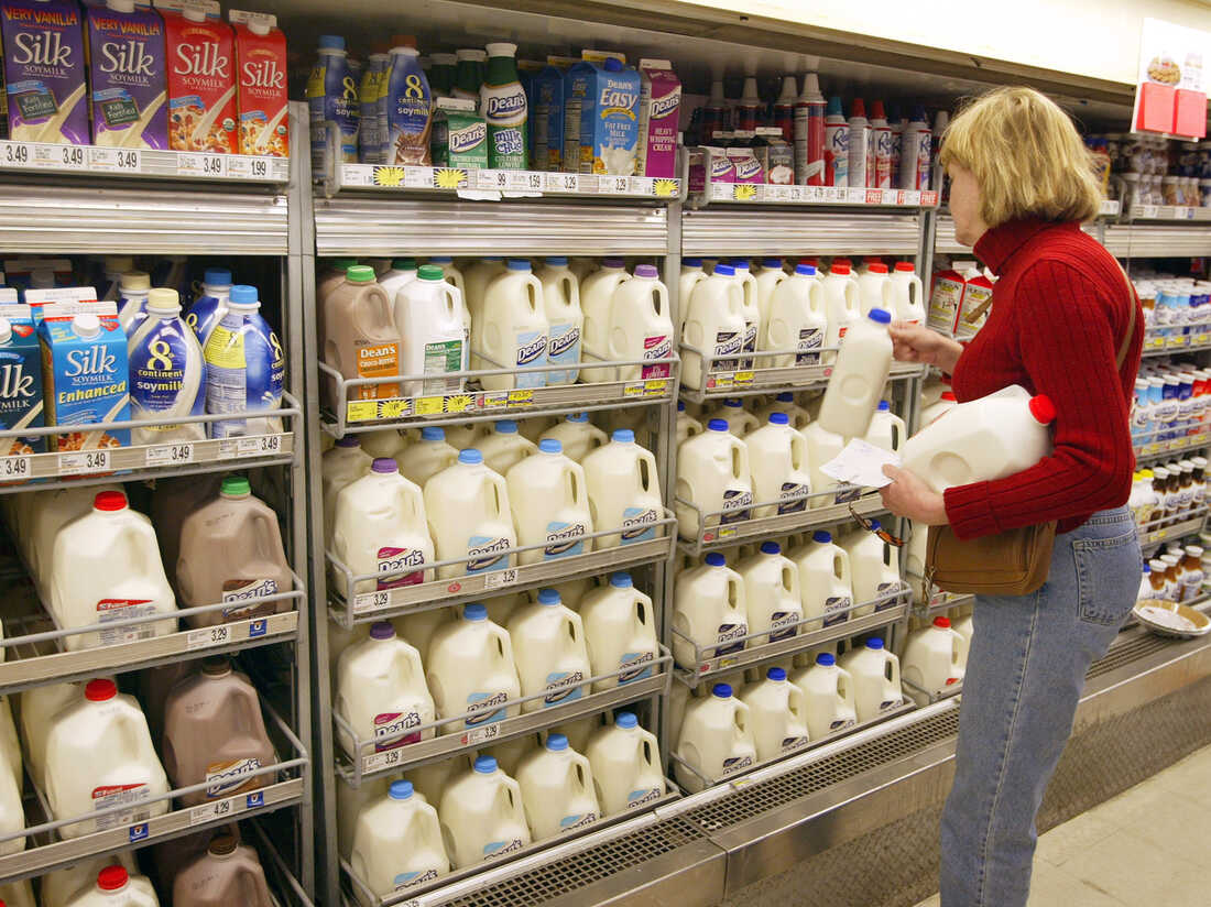 Planet Money wants to know: Why is the milk in the back of the store? (Photo by Tim Boyle/Getty Images