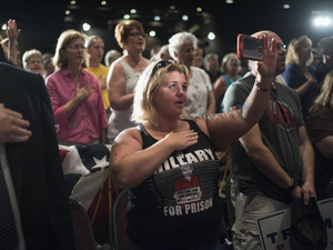 Brandie Seagrove of Harrisburg, Pa., recites the Pledge of Allegiance before Republican vice presidential nominee Mike Pence spoke during a campaign rally in Lancaster, Pa.