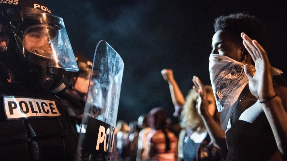 Police officers face off with protesters on Interstate 85 in Charlotte, N.C., during demonstrations following the death of a man shot by a police officer on Tuesday. (Sean Rayford/Getty Images)