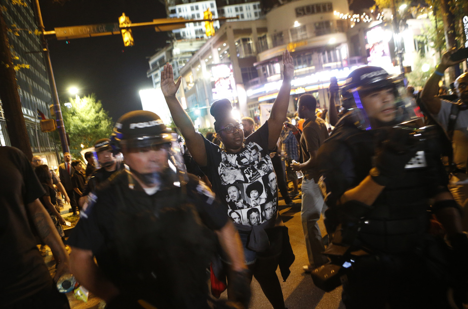 Protesters march Wednesday to protest the Tuesday shooting death of Keith Lamont Scott in Charlotte, N.C. Scott, who was black, was shot and killed by police officers, who say Scott was holding a gun and ignored instructions to drop it. Relatives and neighbors say he was holding a book. (Brian Blanco/Getty Images)