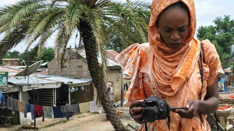 Who's The Woman With The Camera Chasing Smiles And Styles In Nigeria?