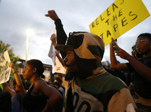 Residents gather Wednesday for a vigil and march to protest the death of Keith Scott in Charlotte, N.C. Scott, who was black, was shot and killed by police. The circumstances of his death are disputed, and residents, the NAACP and the ACLU are calling for the release of police video footage of the shooting.