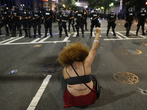A protester demonstrates against the death of Keith Scott in front of police in Charlotte, N.C., on Wednesday.