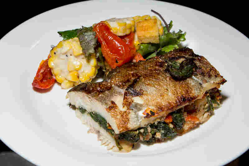 Pan Roast Rainbow Trout, served with cornbread and mustard greens stuffing and hazelnut brown butter, a seafood offering in the Western Range.