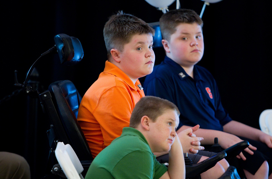 Duchenne muscular dystrophy patients Jack Willis (center), Nolan Willis (right) and Max LeClaire, attended the opening of Sarepta Therapeutics new headquarters in Cambridge, Mass., in 2014. (Boston Globe via Getty Images)