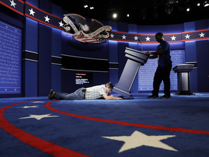 Technicians set up the stage for the Sept. 26 presidential debate between Democratic presidential candidate Hillary Clinton and Republican presidential candidate Donald Trump at Hofstra University in Hempstead, N.Y.