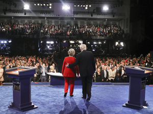 Presidential candidates Hillary Clinton and Donald Trump acknowledge their debate audience Monday night at Hofstra University. Tens of millions more were watching elsewhere.