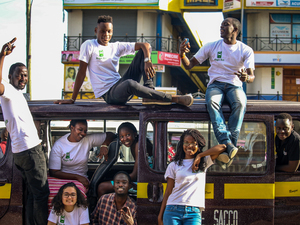 Magic bus team posing on a Matatu van in Nairobi, Kenya.