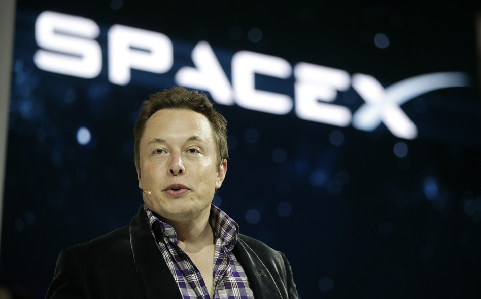Elon Musk, CEO and CTO of SpaceX, introduces the Dragon V2 spaceship at the company's headquarters in Hawthorne, Calif., in May 2014. Musk predicted during an interview at the Code Conference in Southern California on June 1 that people would be on Mars in 2025. (Jae C. Hong/AP)