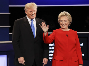 Republican presidential nominee Donald Trump and Democratic presidential nominee Hillary Clinton are introduced at the start of Monday night's presidential debate at Hofstra University in Hempstead, N.Y.