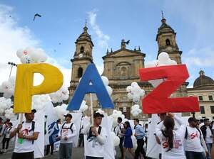 "Colombians in the capital Bogota hold up the letters for ""peace"" in Spanish on Monday. The Colombian government and the FARC rebels signed a peace agreement, marking an end to the last war in the Western Hemisphere. Colombia's civil war lasted more than 50 years and Latin America has had civil wars for the past six decades."