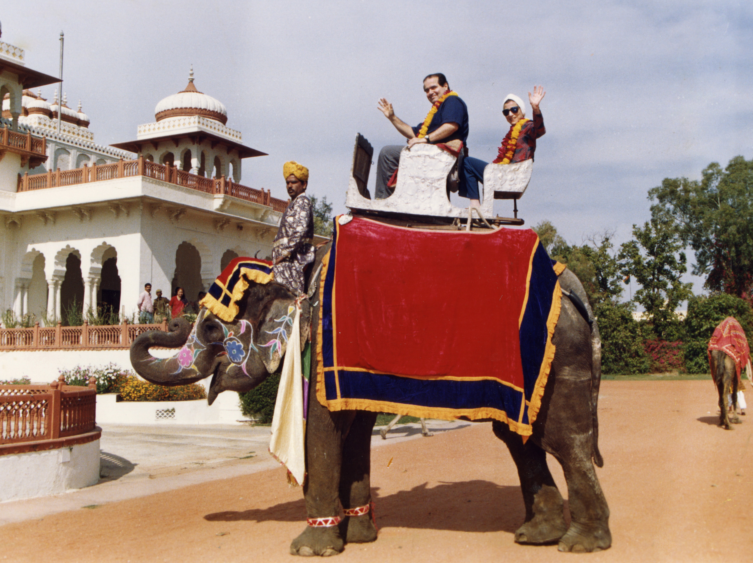 Justice Antonin Scalia and Justice Ginsburg pose on an elephant during their tour of India in 1994. Courtesy of Collection of the Supreme Court of the United States/Simon & Schuster
