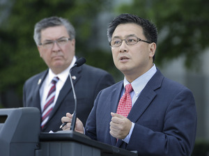 State Treasurer John Chiang, (right) at a news conference in Sacramento, Calif., in May.