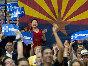 People in the audience cheer as Democratic presidential candidate Hillary Clinton speaks in Phoenix, Ariz., in March.