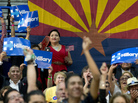 People in the audience cheer as Democratic presidential candidate Hillary Clinton speaks in Phoenix in March.