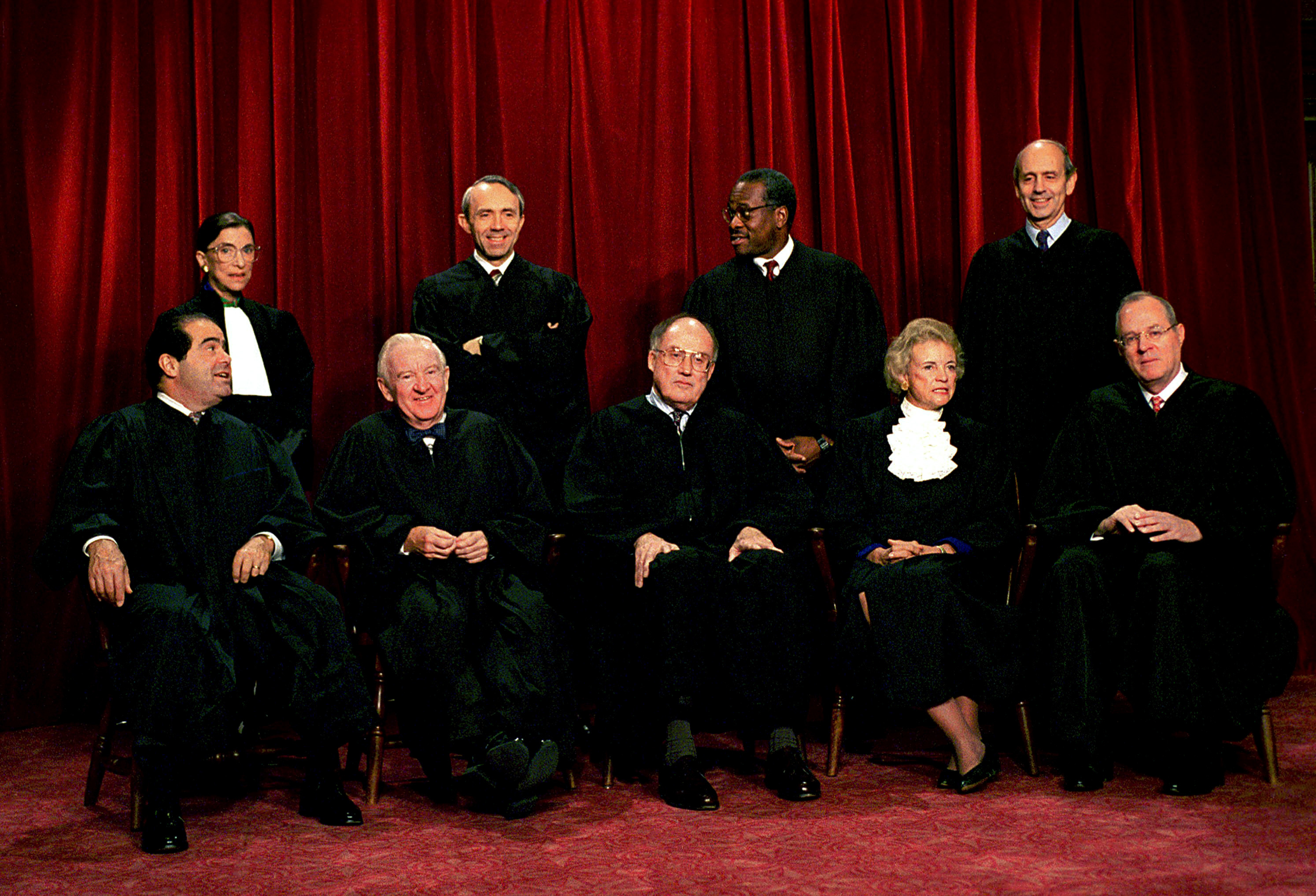 Justices of the U.S. Supreme Court pose for a group portrait in 1994 (from left, front): Associate Justices Antonin Scalia and John Paul Stevens, Chief Justice William Rehnquist, Associate Justices Sandra Day O'Connor and Anthony Kennedy; (from left, back) Associate Justices Ruth Bader Ginsburg, David Souter, Clarence Thomas and Stephen Breyer. J. Scott Applewhite/AP