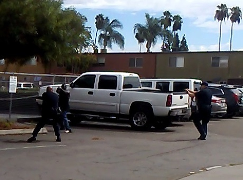 Police in El Cajon, Calif., provided this image, which they say is a still from a bystander's cellphone video of the shooting of an unarmed black man on Tuesday. Police say the man was pointing an object — which was not a weapon — at an officer. (El Cajon Police Department)