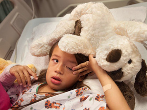 Mimi Morales recovers in Children's Hospital of Orange Country in late September after surgery for a dental infection she contracted at Children's Dental Group in Anaheim, Calif. She had three permanent teeth, one baby tooth and part of her jawbone removed.