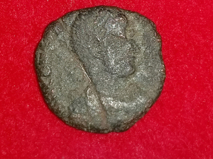 The Uruma city municipal office released this image of a 4th-century copper coin from ancient Rome that was found during an excavation of a castle in Okinawa, Japan.