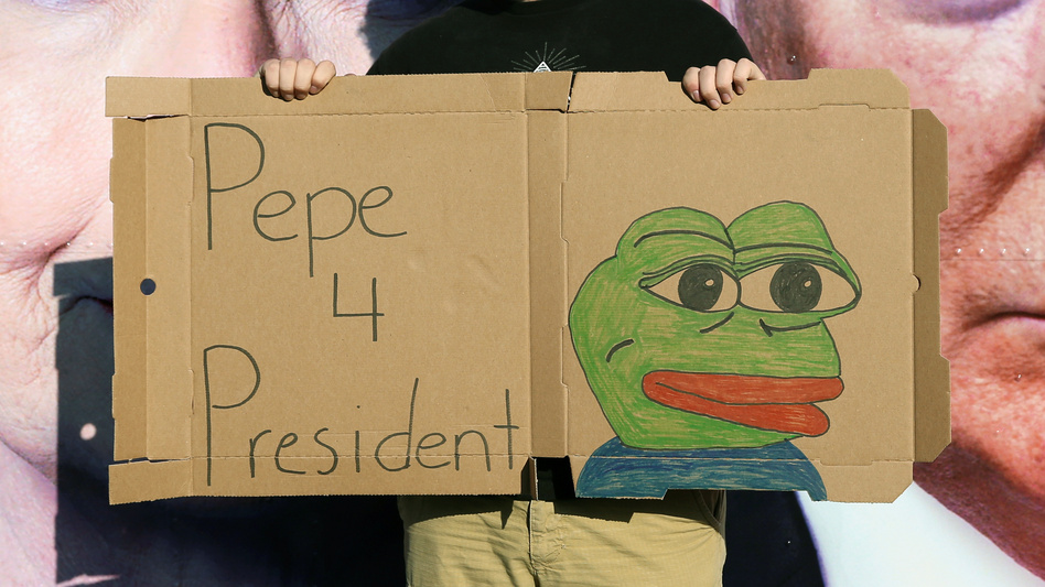 A man poses with a sign of Pepe the Frog outside Hofstra University in Hempstead, N.Y., site of Monday's first presidential debate between Donald Trump and Hillary Clinton. (Shannon Stapleton/Reuters)