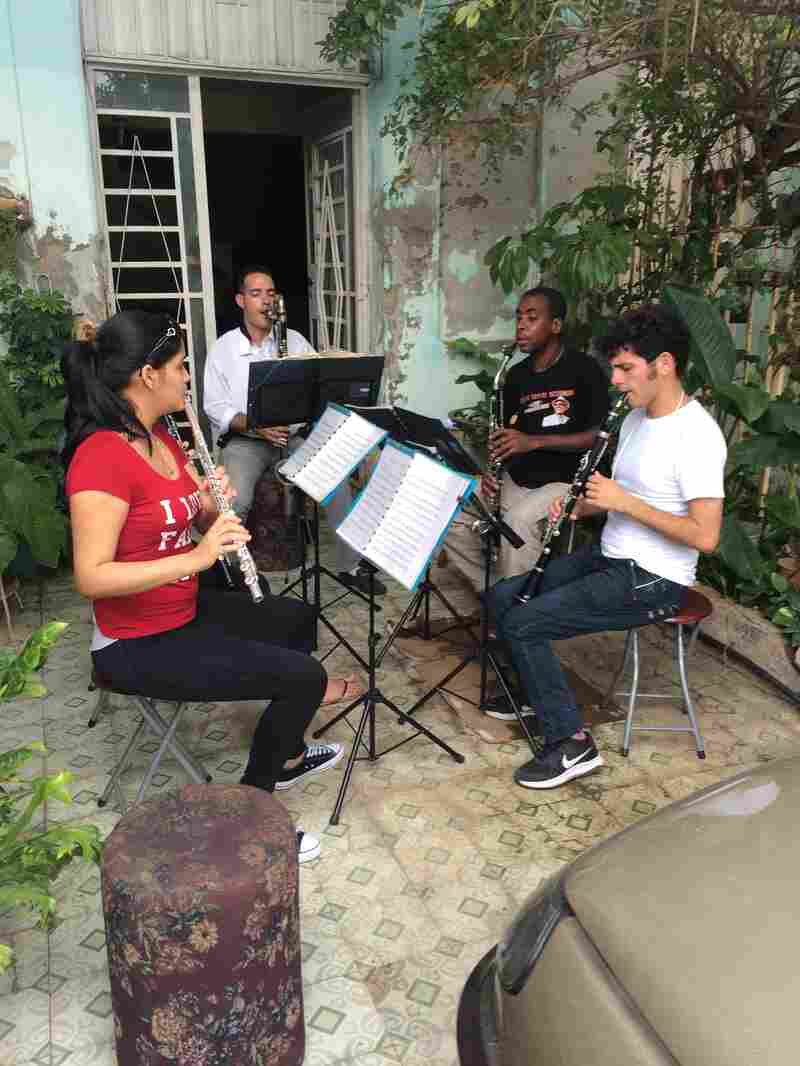 A classical wind ensemble practices at its leader's home, the music wafting throughout the Vedado neighborhood.