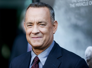 Tom Hanks walked the red carpet at the premiere of Sully in Los Angeles on Sept. 8. He also walked into a couple's wedding pics in Central Park recently.