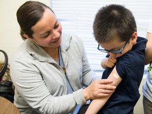 Luz Barajas took her son Carlos Cholico to get his flu shot at Crawford Kids Clinic in Aurora, Col., last year. Health officials say there is some evidence the flu shot is more protective than the nasal flu vaccine.