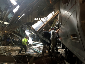 Train personnel survey the NJ Transit train that crashed in to the platform at the Hoboken Terminal on Thursday.