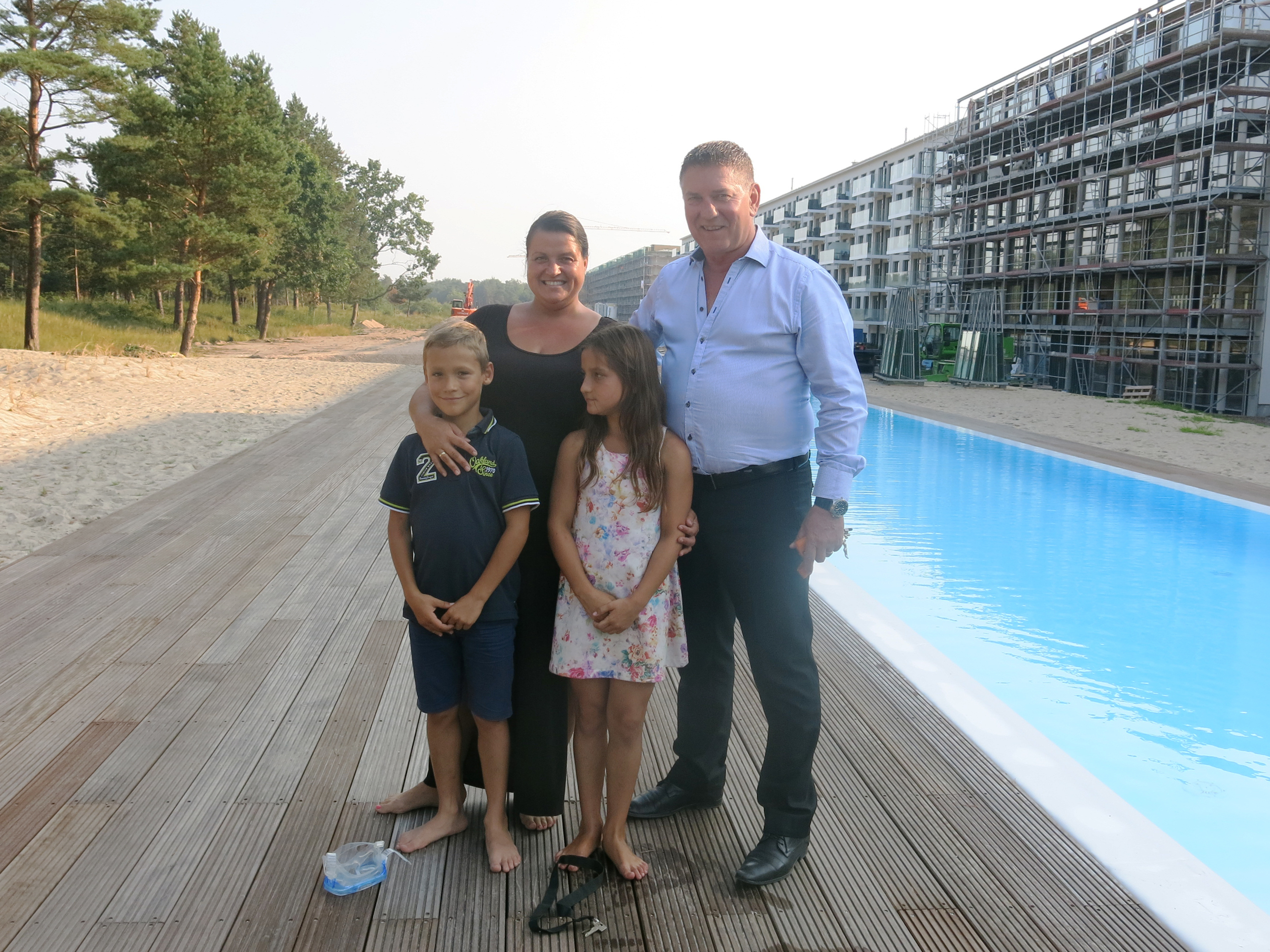 Peter and Yvett Sadewasser and their 8-year-old twins, Alexander and Josefina, were among the first families to move into one of the refurbished units. Soraya Sarhaddi Nelson/NPR