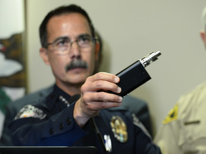 El Cajon, Calif., Police Capt. Jeffery Davis holds up a vape device similar to the one that police say Alfred Olango was holding when he was shot on Tuesday. Davis held a news conference on Friday to release cell and surveillance video of the incident.