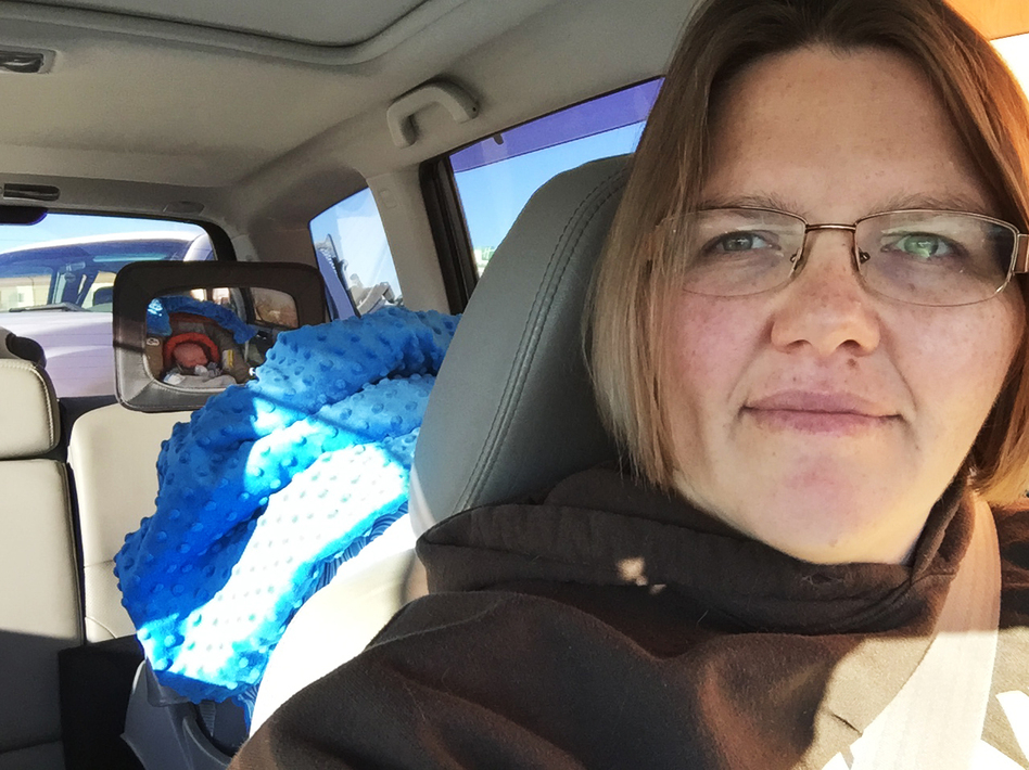 Tricia Olson takes a selfie of herself and her son Augustus, or Gus, who sits in his car seat. Olson took three weeks of unpaid leave from her job at a towing company in Rock Springs, Wyo., after giving birth. (Courtesy of Tricia Olson)