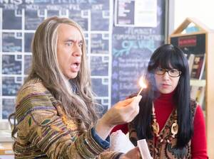 Fred Armisen and Carrie Brownstein perform in a sketch from Portlandia at the Other Words bookstore in Portland, Ore.